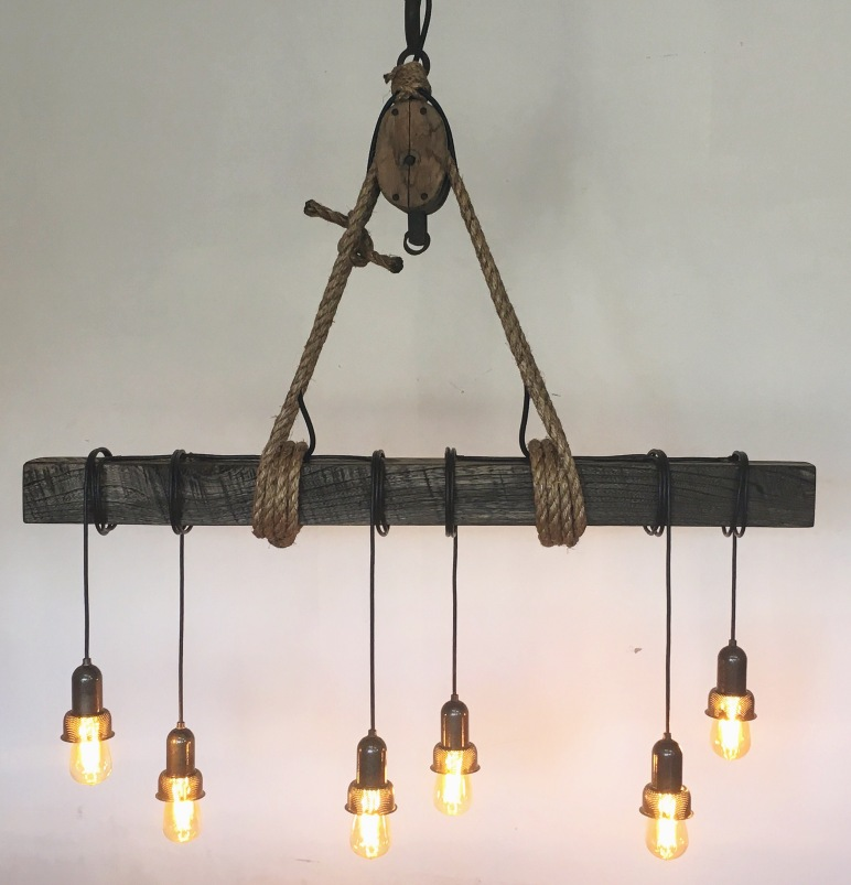 Rustic oak beam and iron pulley chandelier jalo woodshop jalos first project was an oak beam chandelier suspended by natural rope and an antique pulley we used a quarter sawn white oak beam and stained it aloadofball Images